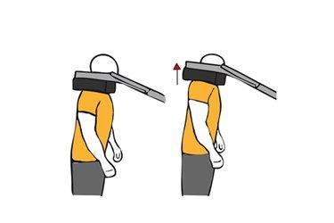 Encogimiento de hombros en maquina de gemelos de pie