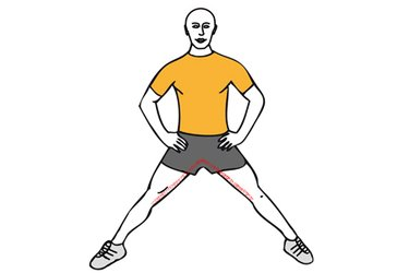 Estiramiento de aductores de pie con piernas abiertas