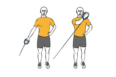 Elevación frontal de hombros con cable-polea de pie